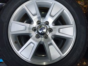 """Ford F-150 20"""" stock rims on perrilli tires for Sale in Tacoma, WA"""