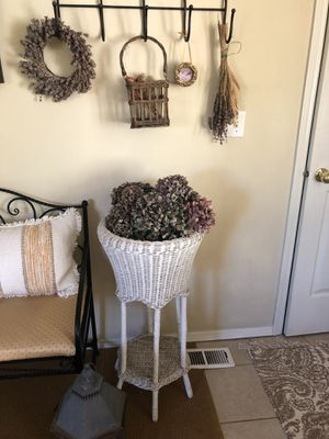 Vintage wicker plant stand with large bouquet of dried hydrangeas for Sale in Vancouver, WA