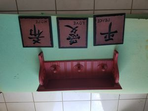 Shelf with 3 prong coat hanger and three small frames for Sale in Victorville, CA