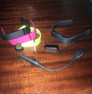 Fitbit with accessories included! 3 small wristbands, 1 large blk wristband, usb charger, & wireless sync dongle for Sale in Jacksonville, FL