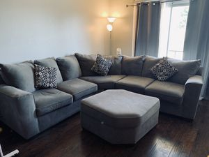 Sectional couch with foot rest, has a couple pen marks on the sides for Sale in San Jose, CA