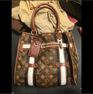 Louis Vuitton limited Tisse Rayures tote, some stains in the inside, corners have minor scuffs, outside in very good pre-own condition. See all pictu for Sale in New York, NY