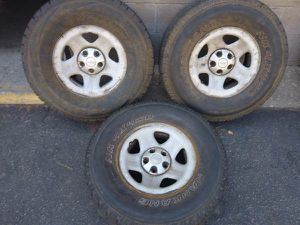 Three Jeep steel rims and 31 inch tires 5 lug Dodge, Ford, Toyota for Sale in Montebello, CA