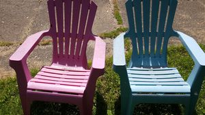 2 Nice Stackable Patio Camping Outdoor Adirondack non wood plastic chairs one pink one blue for Sale in Brook Park, OH
