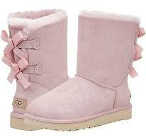 UGG Boots (pink sueid with bows) for Sale in Peoria, IL