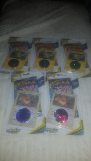 5 Pokemon packs with foils and coin for Sale in Matthews, NC