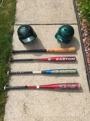 Lot of 4 Used baseball bats and 2 baseball helmets for Sale in South Amherst, OH
