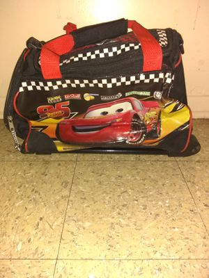 Child's cars bookbag/suitcase on wheels for Sale in Quincy, IL