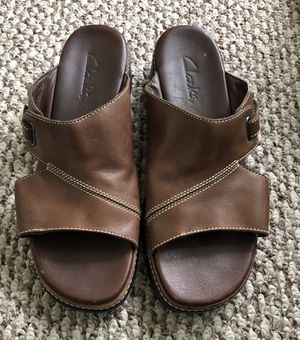 CLARKS Women's Brown Leather Wedge Mule Sandal Size 9. Cushioned and comfortable. Smoke free home. for Sale in Washington, DC
