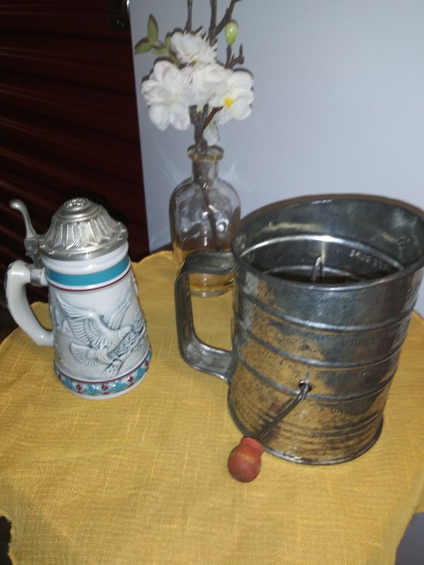 Old sifter. Decoration only use. Old tankard. Decoration use only