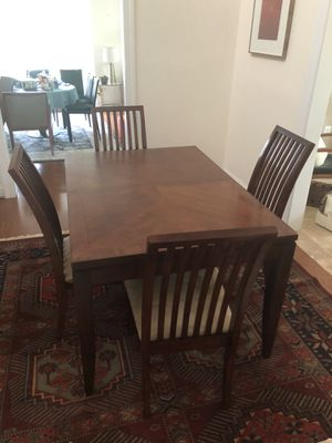 "Dining table with extension and four chairs. 66"" with a 12"" extension. $150 for Sale in Fairfax, VA"
