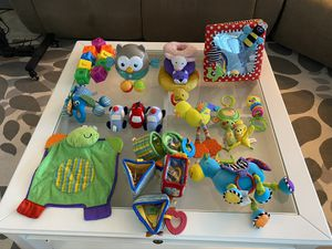 Baby toy lot and cup holder for stroller for Sale in Kissimmee, FL