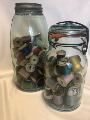 Vintage jars with vintage spools of thread for Sale in Spokane, WA