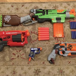 Nerf gun lot with Zombie Strike Slingfire, Mega Cycloneshock, Hammer Shot, and more for Sale in Culver City, CA