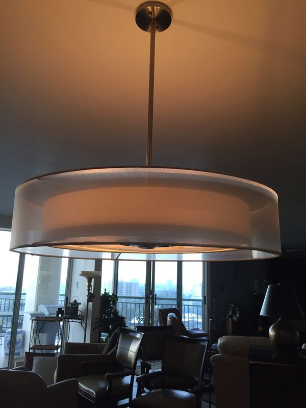 Get ready for the holidays with this elegant Metropolis double-drum pendant over your table!