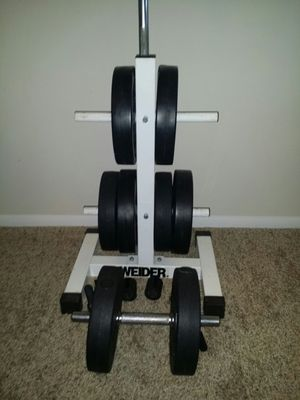 Weights vinyl 80lbs. 8x10lbs, weider 2 tier weight tree, 6 foot barbell with weight plate holders and 1 dumbbell bar. for Sale in Deerfield Beach, FL