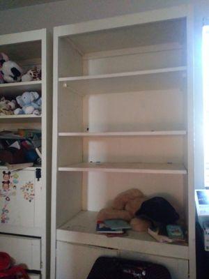 Sturdy white bookcase with bottom storeage . for Sale in Miami, FL