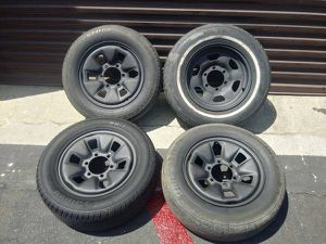 6 lug steel 15 inch rims and old tires. Toyota, Chevy, Nissan, more for Sale in Montebello, CA