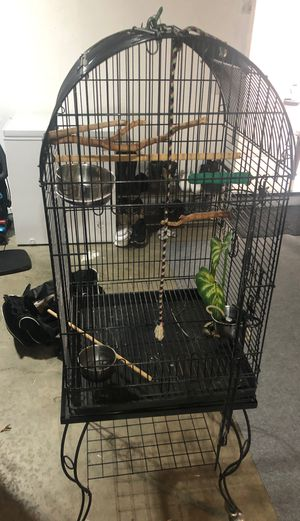 Rolling Bird Cage. Includes all items shown. 6- Attachable sticks. 1- water pump-missing ac connector, 3-stainless bowls and bowl holders for Sale in Moreno Valley, CA