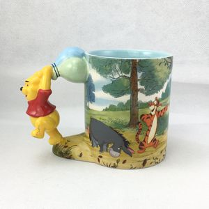 Disney Winnie the Pooh collectible mug small crazing fracture in foot but not broken for Sale in Buda, TX