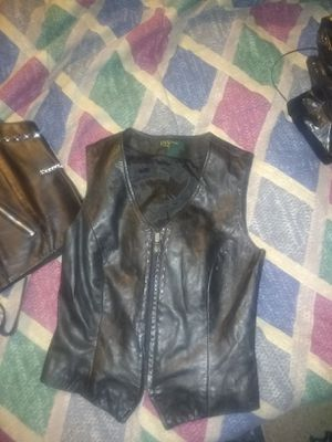 Motorcycle gear... 2 vests pair of leather pants size 30 boots size 11 for Sale in Leesburg, FL