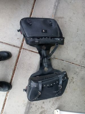 Saddle bags, damage from sitting on pipe. Used a couple times for Sale in Glendale, AZ