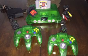 Clear green Nintendo 64 w Mario Party 3 w 2 original Controllers and cables for Sale in National City, CA
