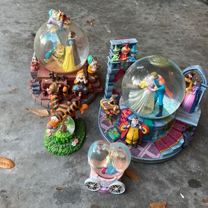 4 Disney Snow Globes For $60 for Sale in Lutz, FL