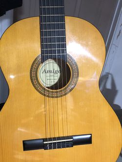 Amigo Guitar - Pristine Condition, PRICE NEGOTIABLE includes guitar case and clip for Sale in Silver Spring,  MD