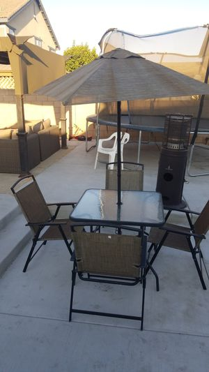Patio set, glass patio table 4 foldable chairs n umbrella for Sale in Montclair, CA