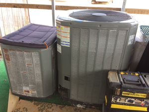 Two AC air-conditioning condensers both work come out of a big home for Sale in West Palm Beach, FL