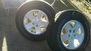 I have 5 tires and wheels p225/75/r / 17 that are off of a late model Jeep Wrangler four are in great shape one is brand new for Sale in Westminster, CO