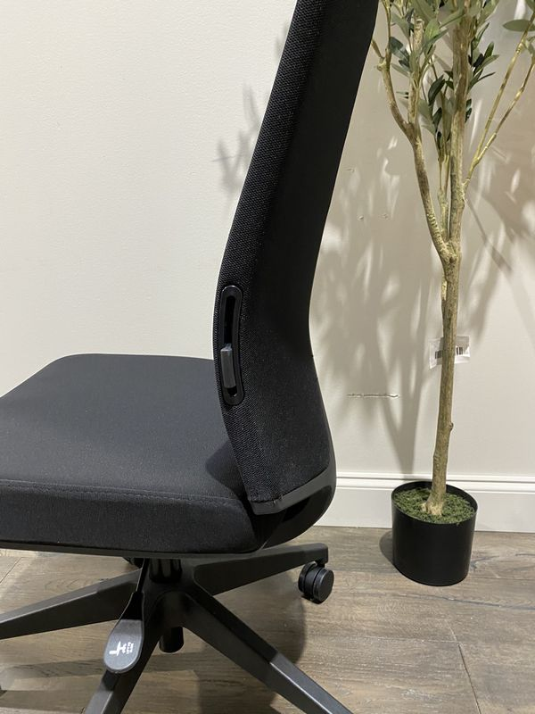 Office chair. Ours is without arms. MSRP $210. Our price $60 + sales tax