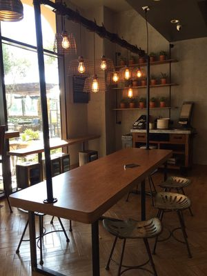 Industrial Chic Café Tables with Steel lighting posts (bronze) and String Lights for Sale in Long Beach, CA