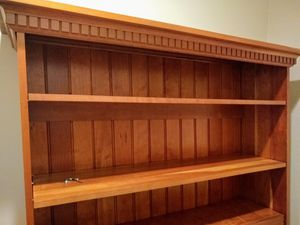 Solid wood bookcase. Adjustable shelves topped with Greek Dental detail. Walnut finish. for Sale in Oak Park, IL