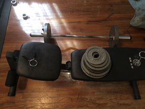 Weight set with 300 pounds of weight curl bar and incline bench and extra curl bars and mat for Sale in Leggett, NC