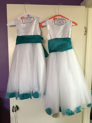 Matching flower girl dresses. Worn once. Size 6 and size 10. for Sale in Los Angeles, CA