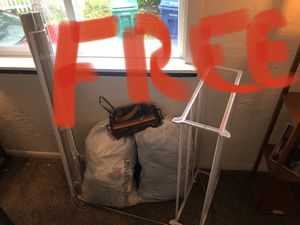 Pending pickup. FREE Shoe rack, blinds, purse, bed sheets, pillowcases, women's clothing for Sale in Seattle, WA