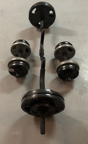 Brand new standard steel weight plates and combo curl bar, with a set of adjustable dumbbell handles!! All new!! 85lbs of weight weight plates! for Sale in Cave Creek, AZ