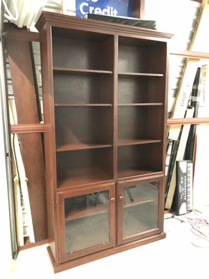 Cherry Bookcase Storage Cabinet with glass doors 12 shelves retail $750 letting go for $250 for Sale in Austin, TX
