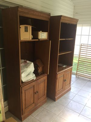 Two oak cabinets with shelves and storage for Sale in Brecksville, OH