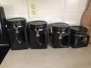 Four black kitchen storage containers with spoons for Sale in Derby, KS