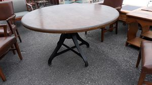 54 inch roud table with iron base for Sale in High Point, NC