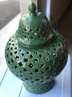 Beautiful decorative large The green glass with the holes and fat belly with top is 21 inches tall and 39 for Sale in Linthicum Heights, MD