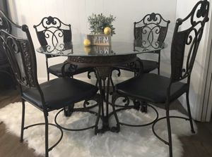 Beautiful excellent condition extremely heavy wrought iron glass dining room table and 4 leather chairs for Sale in Lodi, CA