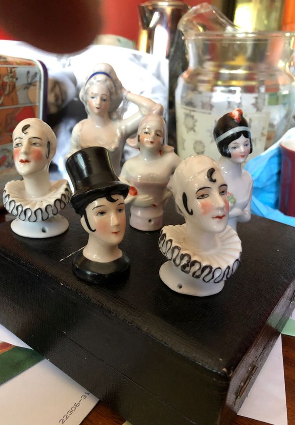 Antique half dolls used in a variety of ways