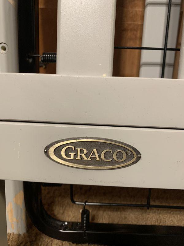 Gray Graco Crib Model number 04526-31F