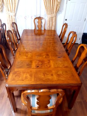 Beautiful wood dining room table with 8 chairs. EXELLENT CONDITION. Table has a big leaf. 2 chairs have arms. 6 chairs no arms for Sale in Houston, TX