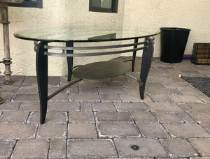 Crate and Barrel Oval Glass Iron Base Coffee Table. Beautiful and in great condition! Dimensions are 54in W x 28in D x 17in H for Sale in Scottsdale, AZ