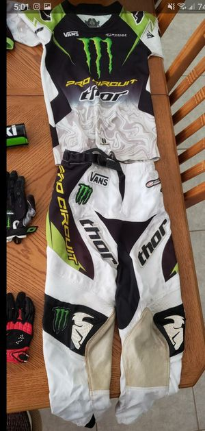 Fox ,Thor monster energy youth dirt bike riding gear (two sets) helmets, pants, shirts, gloves etc for Sale in Lutz, FL